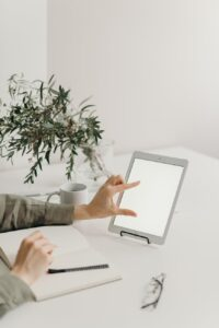 person holding white tablet computer